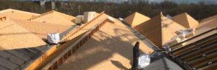 Nieuw Cronos-gebouw met grijze bitumineuze dakafdichting